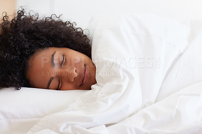Buy stock photo Shot of a young woman asleep in her bed