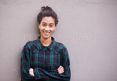 Buy stock photo Portrait of a trendy young woman standing against a gray wall