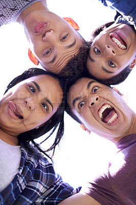 Buy stock photo Low angle portrait of a group of young friends