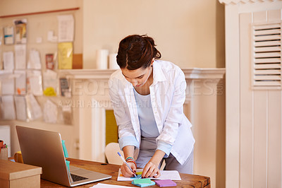 Buy stock photo Cropped shot of a young businesswoman working from home