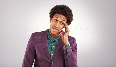 Buy stock photo Cropped shot of a young man standing against a gray background