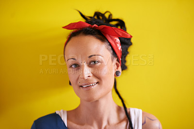 Buy stock photo Portrait of a young woman with dreadlocks standing against a yellow background