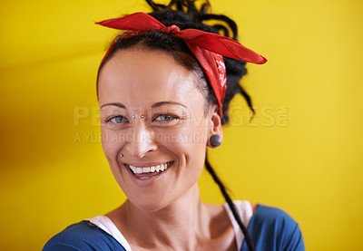 Buy stock photo Cropped portrait of a young woman with dreadlocks standing against a yellow background