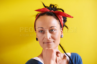 Buy stock photo Cropped shot of a young woman with dreadlocks standing against a yellow background