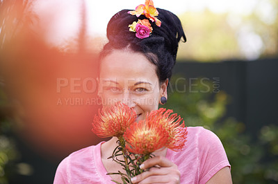 Buy stock photo Cropped shot of a woman holding a bunch of pincushion proteas