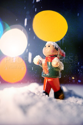 Buy stock photo Closeup shot of a Christmas figurine surrounded by falling snow
