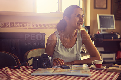 Buy stock photo Shot of a tourist having coffee in a cafe