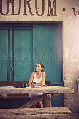Buy stock photo Shot of a tourist having coffee at a sidewalk cafe