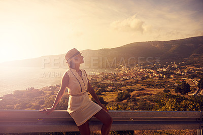 Buy stock photo Shot of a young woman admiring a scenic view