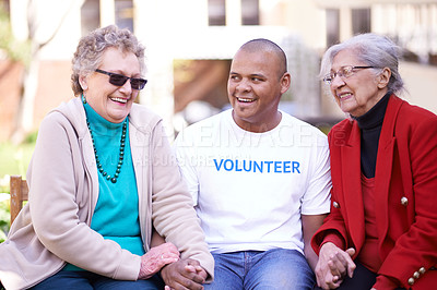 Buy stock photo Shot of a volunteer worker with two senior women