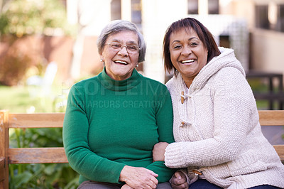 Buy stock photo Two senior women sitting outside having a friendly conversation
