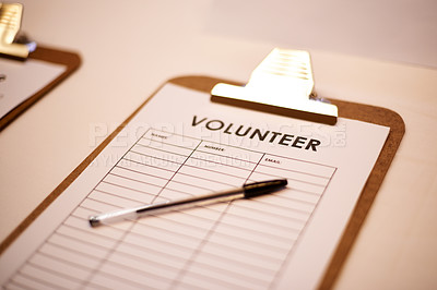 Buy stock photo Shot of a volunteer list on a table