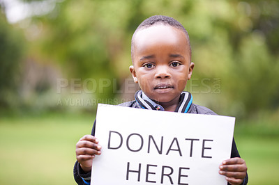 Buy stock photo Cropped shot of a young boy holding a