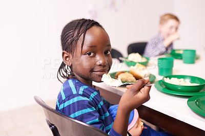 Buy stock photo Cropped shot of a young girl eating a meal