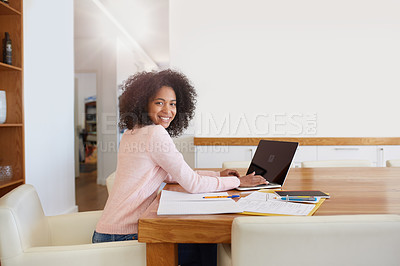 Buy stock photo Cropped portrait of a young woman working on her laptop at home