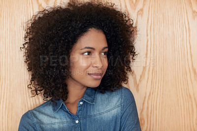 Buy stock photo Shot of an attractive young woman standing in front of  wooden background
