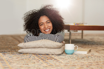 Buy stock photo Portrait of a happy young woman relaxing on the floor at home