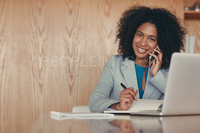 Buy stock photo Portrait of a young businesswoman speaking on the phone at her desk in an office