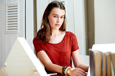 Buy stock photo Shot of a teenage girl using her laptop for her studies