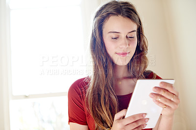 Buy stock photo Shot of a teenage girl relaxing at home