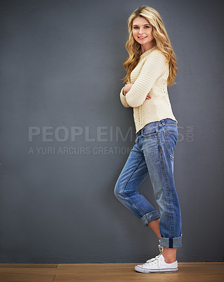 Buy stock photo Portrait of a young woman standing against a gray background