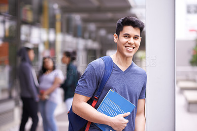 Buy stock photo Portrait of a smiling university student standing on campus with friends in the background
