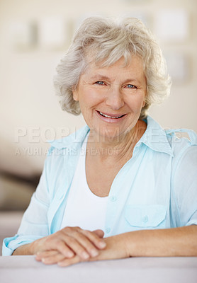 Buy stock photo Portrait of a happy senior woman smiling against a blurred background