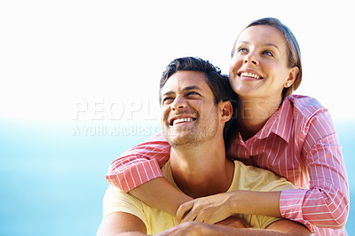Buy stock photo Couple smiling and looking away with woman embracing man from behind