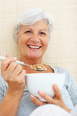 Buy stock photo Portrait of senior woman having breakfast and smiling