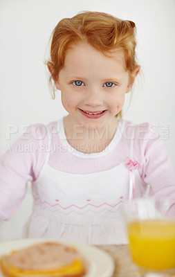 Buy stock photo Portrait of a happy adorable little girl having her breakfast