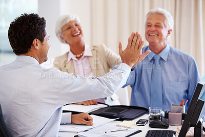 Buy stock photo Elderly couple at financial adviser's office with man giving high five to business consultant