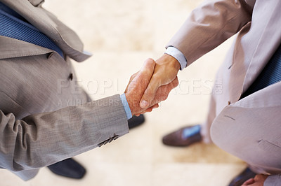 Buy stock photo Top view of a two businessman shaking hands - Welcome to business