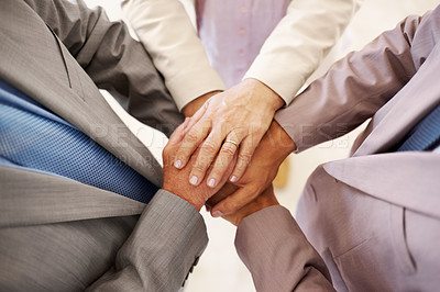 Buy stock photo Closeup of a businesspeople hands on top of each other - Top view