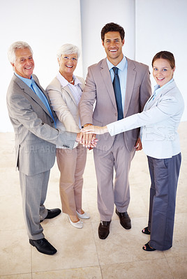 Buy stock photo Successful business people hands on top of each other gesturing unity and teamwork