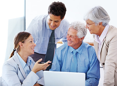 Buy stock photo Team of corporate professionals having friendly discussion during a project meeting