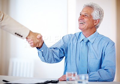 Buy stock photo Portrait of a smiling old businessman making an agreement at office