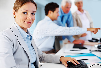 Buy stock photo Portrait of pretty young business woman with colleagues working at the back
