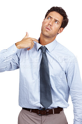 Buy stock photo Portrait of a young male business executive pulling his collar against white background