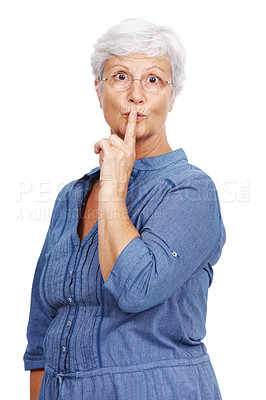 Buy stock photo Portrait of a mature woman with her finger on her lips indicating keep silence against white background