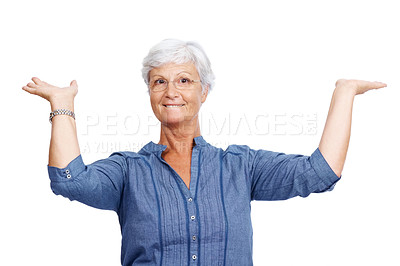 Buy stock photo Portrait of a happy mature woman lifting up something against white background