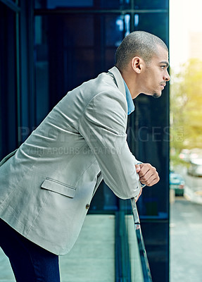 Buy stock photo Shot of a young businessperson standing in their office