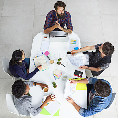 Buy stock photo High angle shot of coworkers having a meeting in a modern office