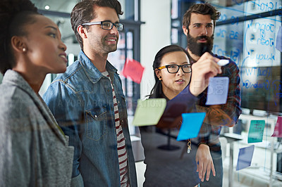 Buy stock photo Cropped shot of coworkers brainstorming in a modern office