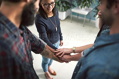 Buy stock photo Cropped shot of a group of creative businesspeople stacking their hands on top of each other