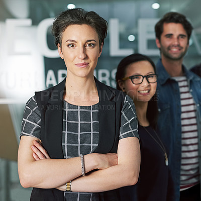 Buy stock photo Cropped portrait of a creative businesswoman standing with her colleagues behind her