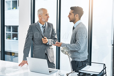 Buy stock photo Cropped shot of two businessmen meeting in their office