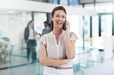 Buy stock photo Shot of a happy young businesswoman talking on her mobile phone at work
