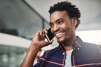 Buy stock photo Cropped shot of a young designer talking on a cellphone in a modern office