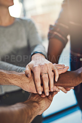 Buy stock photo Closeup shot of three colleagues joining their hands together in unity