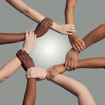 Buy stock photo Cropped shot of a group of hands holding on to each other at the wrist against a grey background
